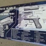 Banner poliplan mari dimensiuni craiova | pistol glock calibrul 9 mm | publicitate craiova
